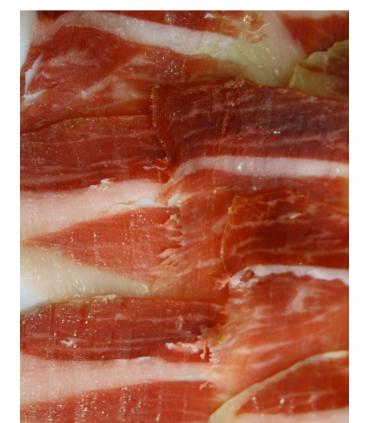 Sliced acorn-fed iberian shoulder ham paletas bellota